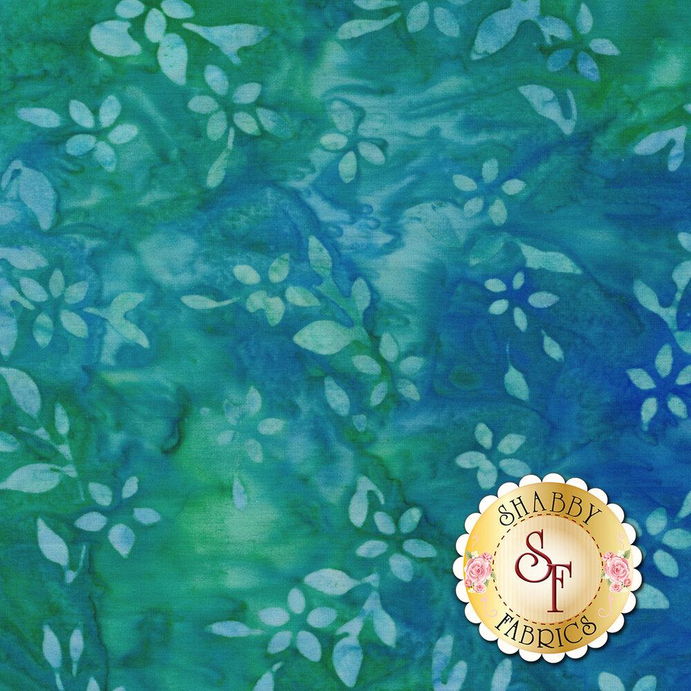 Mottled aqua leaves on a dark blue and green mottled background