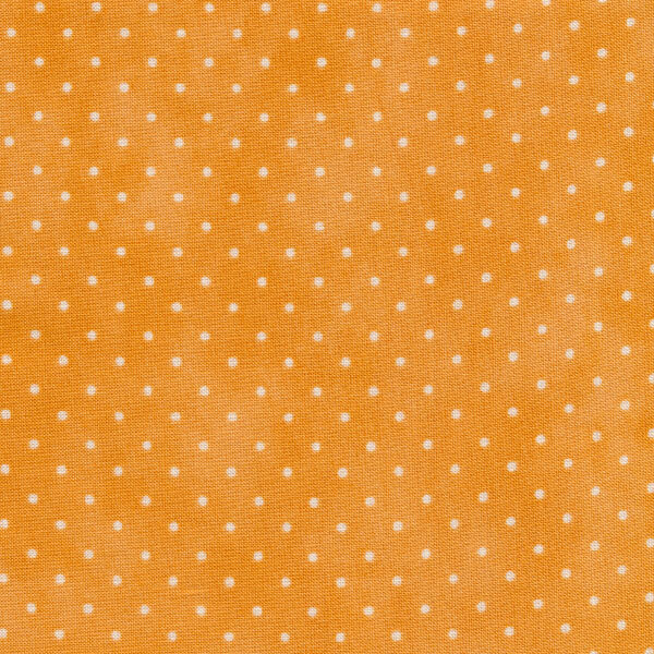 Bright yellow mottled print with small white polka dots