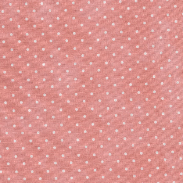 Light pink mottled fabric with small white polka dots