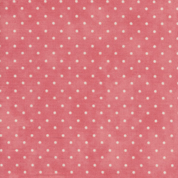 Mottled pink fabric with small white polka dots
