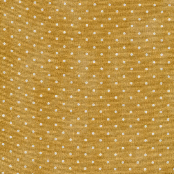 Light brown mottled fabric with small white polka dots
