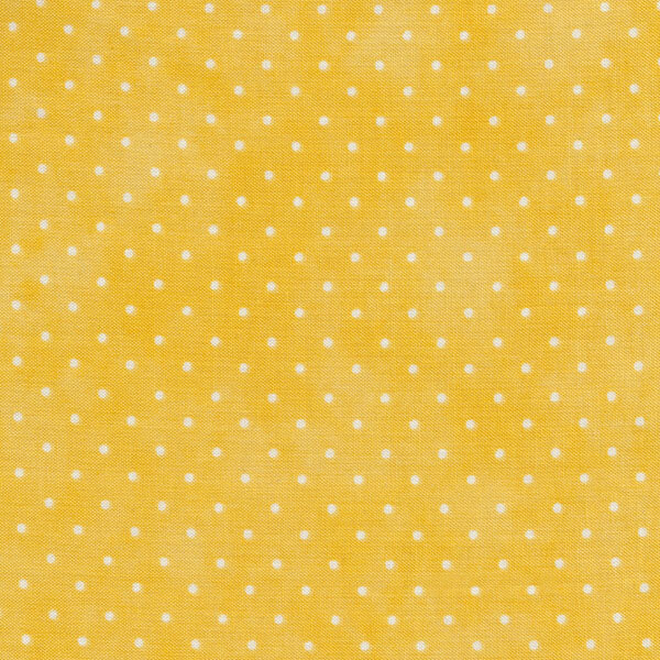 Light yellow mottled print with small white polka dots