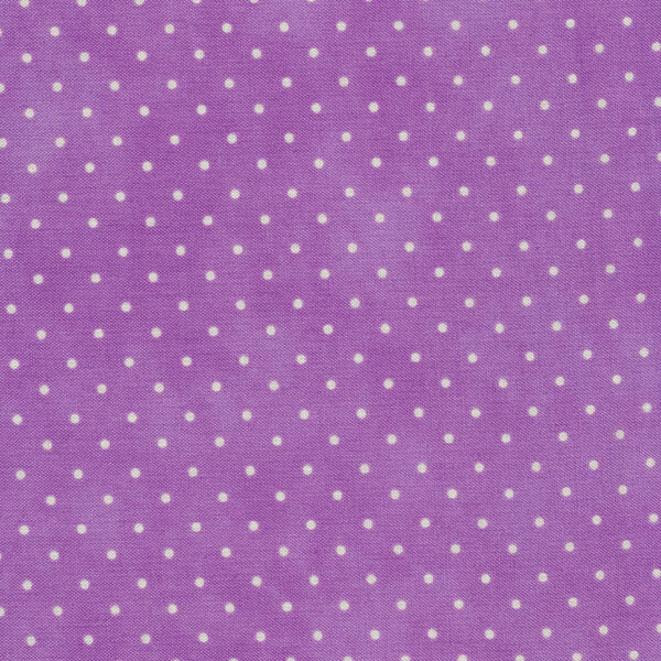 Small white polka dots on a light purple mottled print
