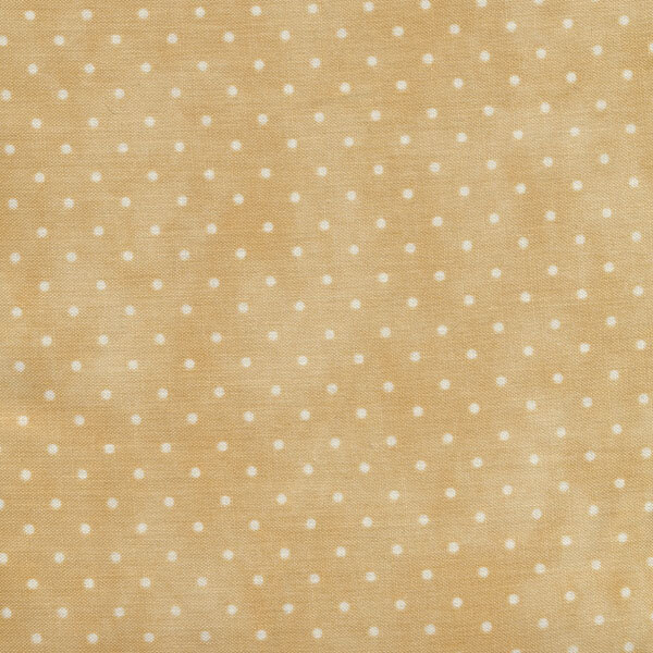 Light tan mottled fabric with small white dots