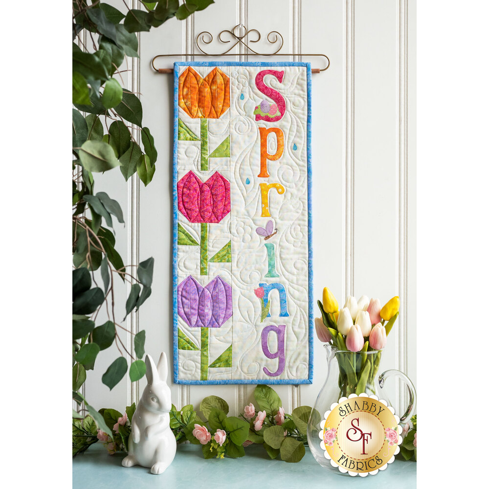 Kit for A Year In Words Wall Hangings April reading Spring with bright colored tulip blocks.
