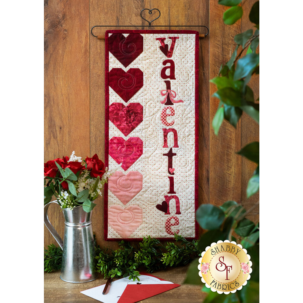 The beautiful February A Year In Words Wall Hanging laid flat on a wood table