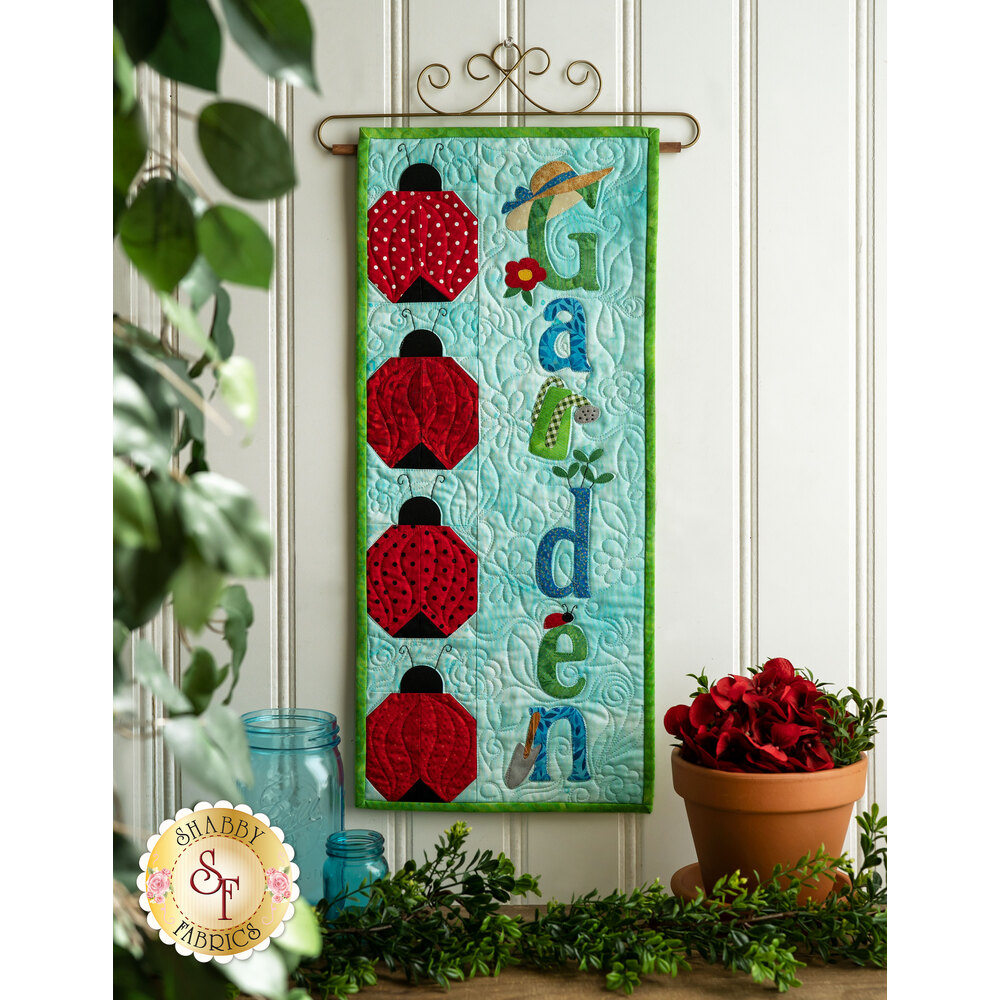 Kit for A Year In Words Wall Hangings June reading Garden with ladybug blocks on blue.