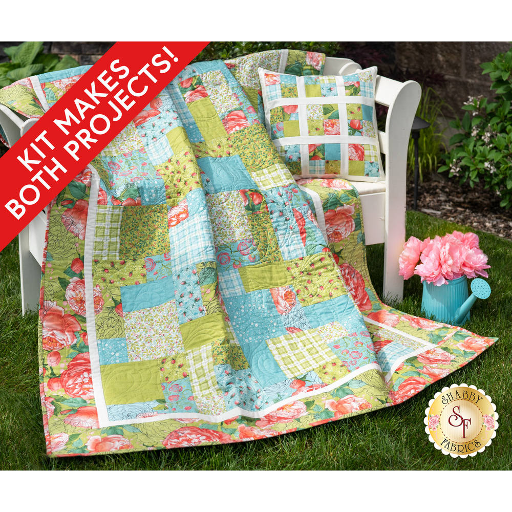 The beautiful Easy As ABC - Abby Rose Quilt draped over a chair outside | Shabby Fabrics