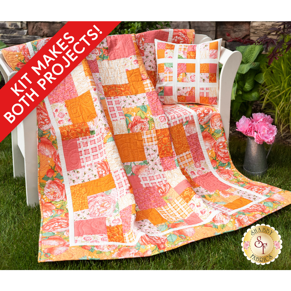 The beautiful Easy As ABC - Abby Rose Quilt in pink draped over a chair outside | Shabby Fabrics