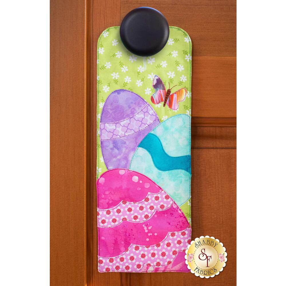 Door hanger kit for A-door-naments April with pink, blue, and purple applique egg.