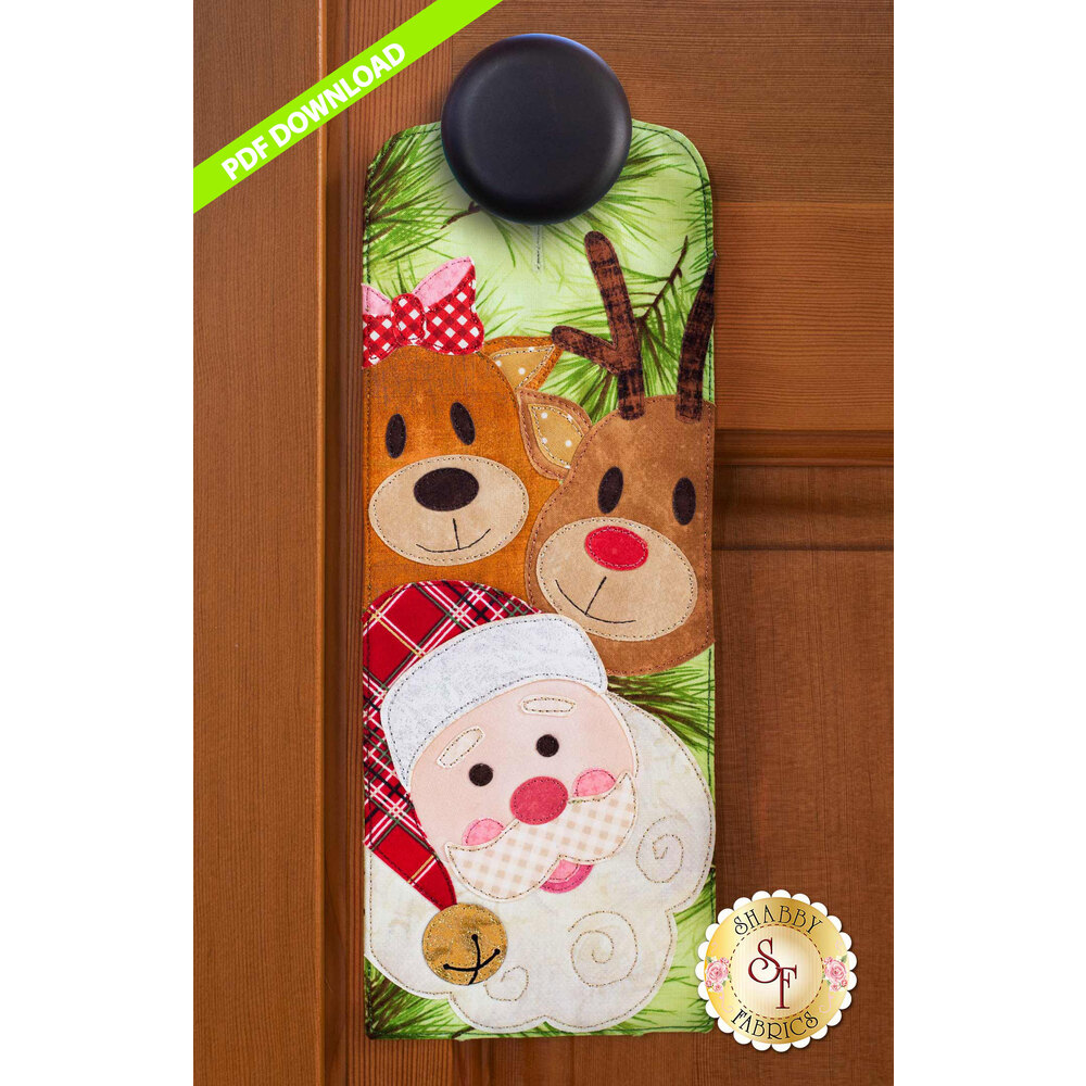 PDF Pattern for for A-door-naments December with two reindeer and Santa on green fabric.