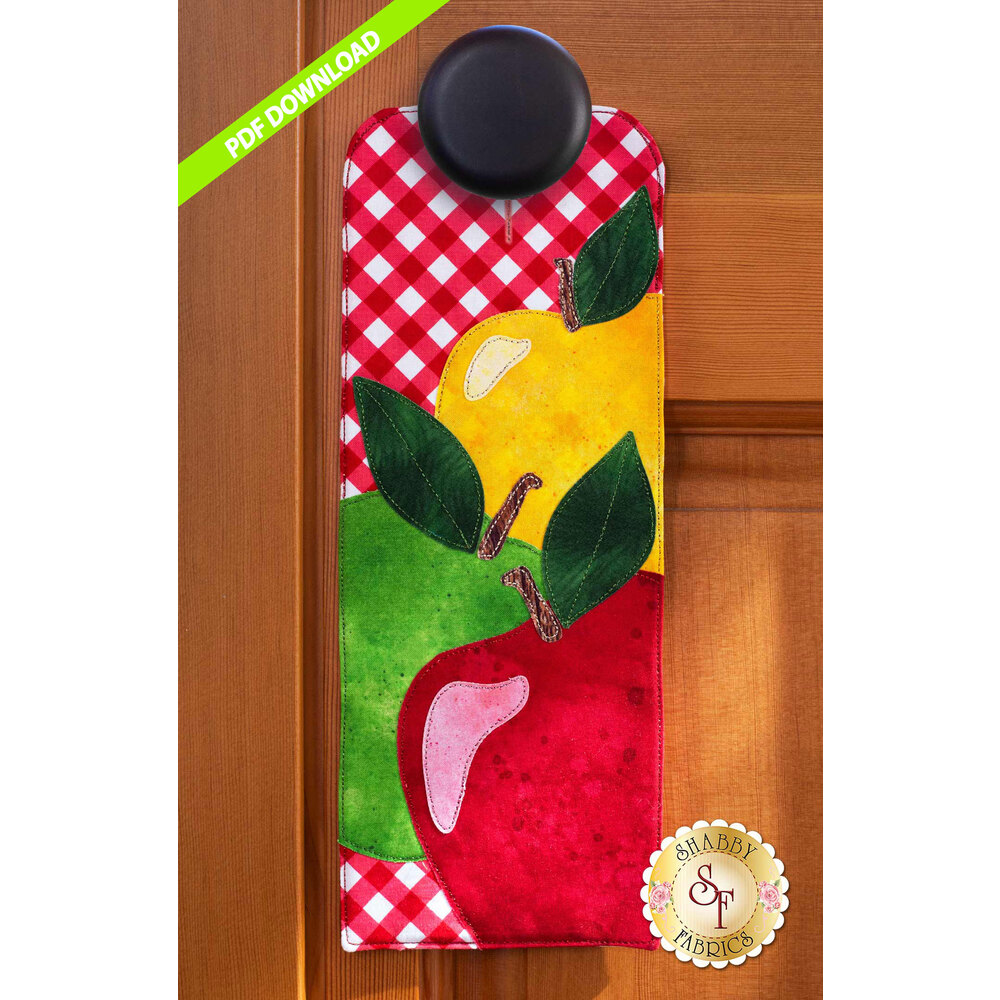 PDF Pattern for A-door-naments September with red, green, and yellow apples on red gingham.