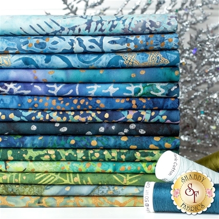 A photography of the 14 fabrics included in the Artisan Batiks: Twilight Snowfall FQ Set