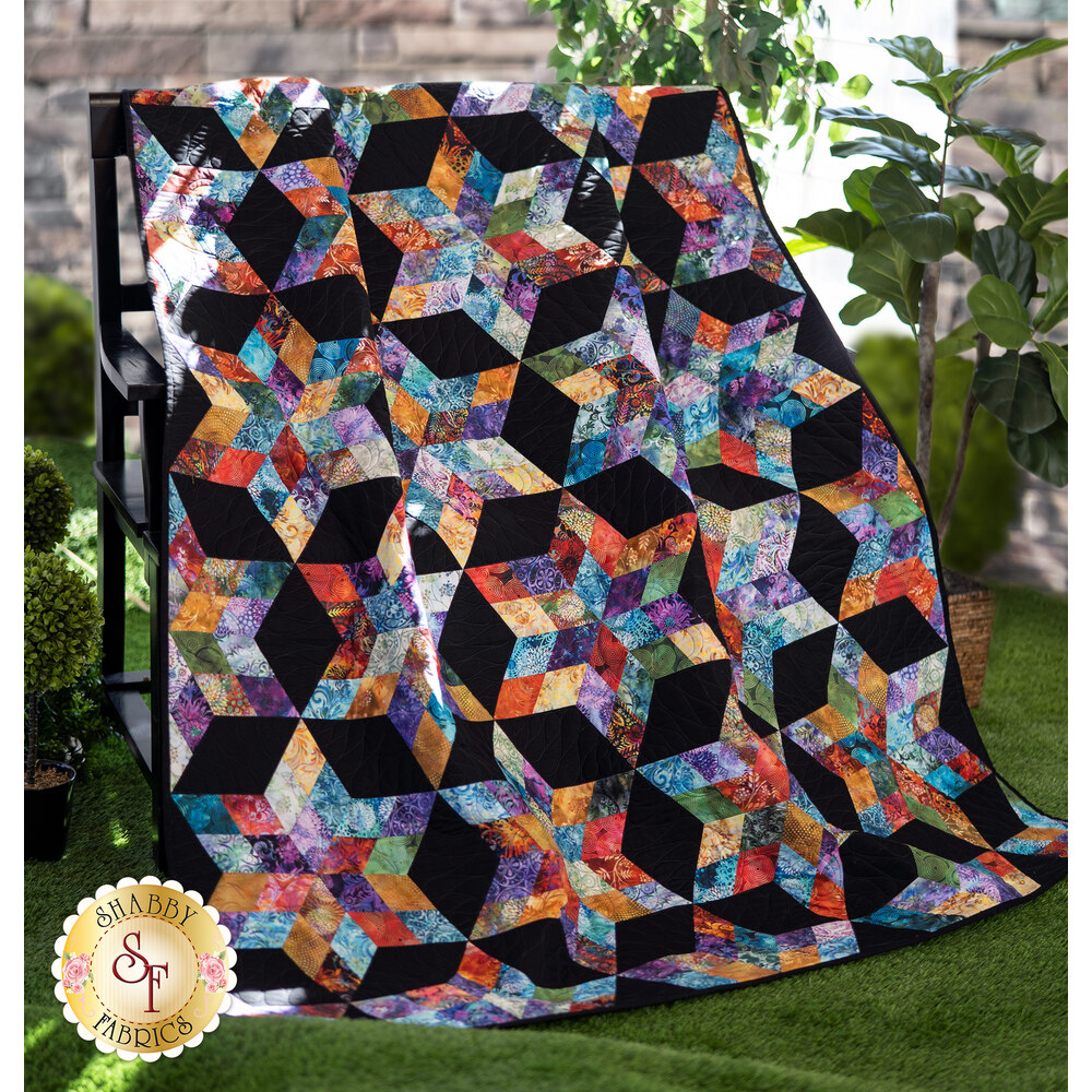 Beautiful quilt with star piecing and bright Floragraphix V fabrics draped outside