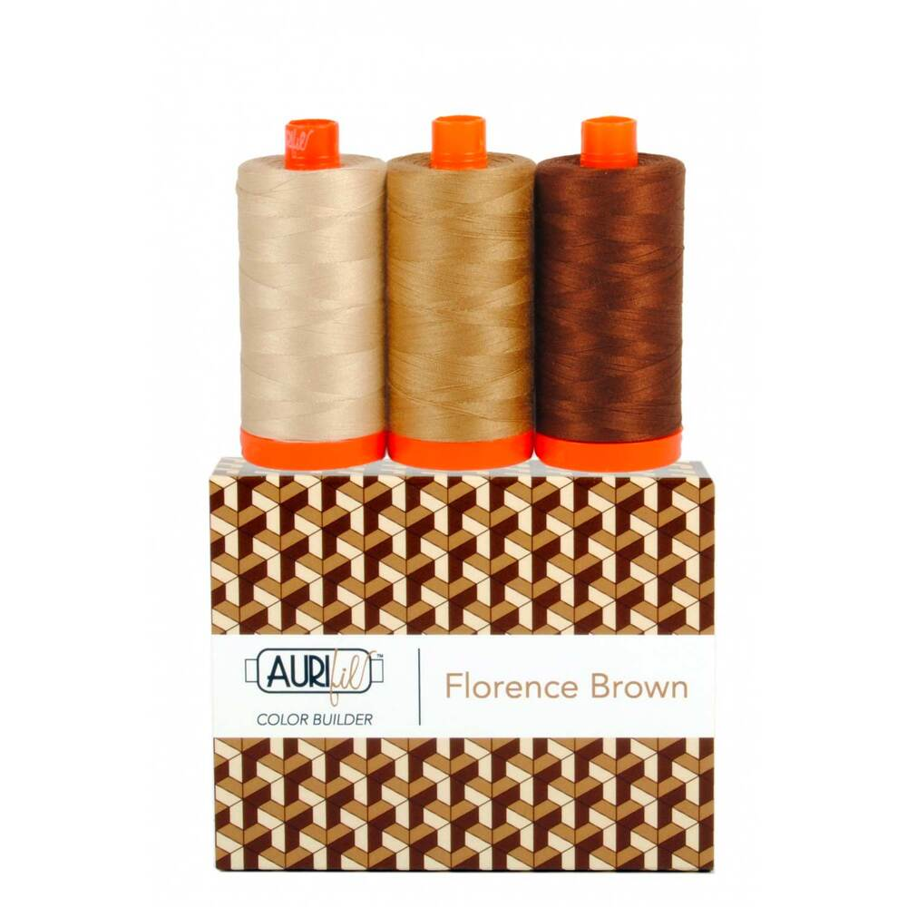 A spool of light tan, medium tan, and dark brown thread on an Aurifil Colorbuilder box