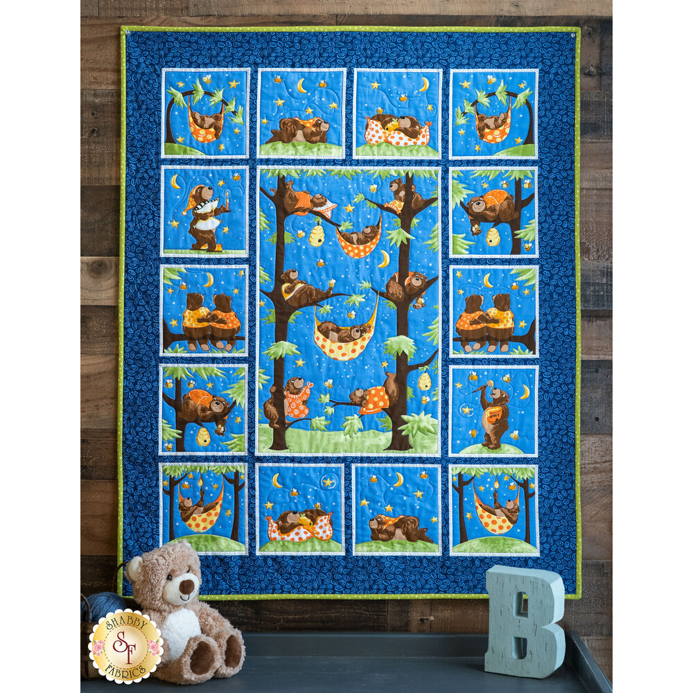 The adorable Barron the Bear Panel Quilt displayed on a wall
