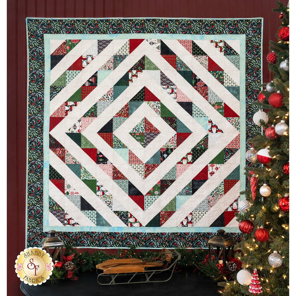 Square quilt with diamond patterns pieced from different fabrics