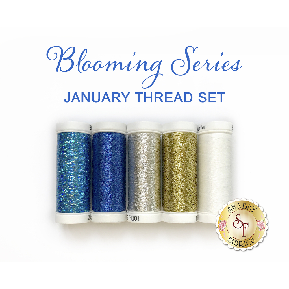 Blue, silver, and gold Sulky Original Metallic and Holoshimmer threads with one white bobbin thread.