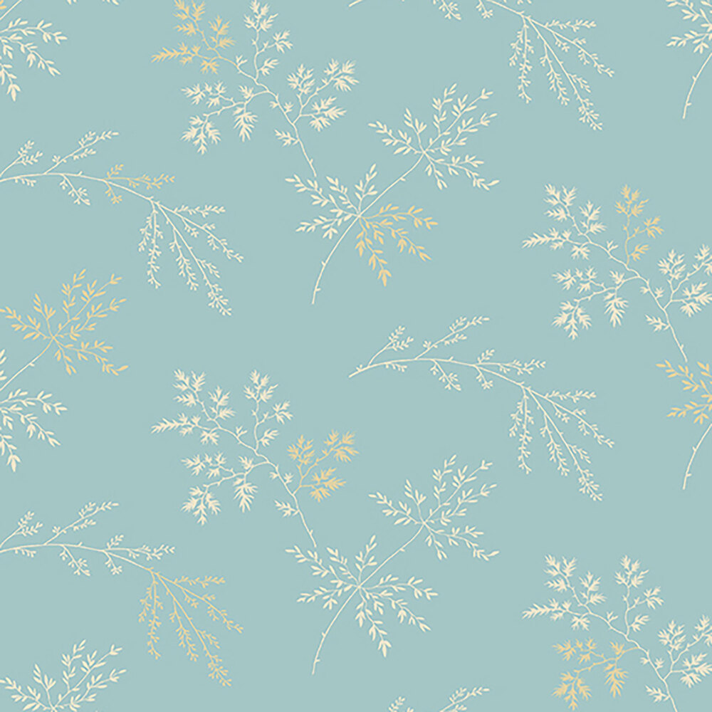 Tossed tan sprigs and leaves on a light blue background