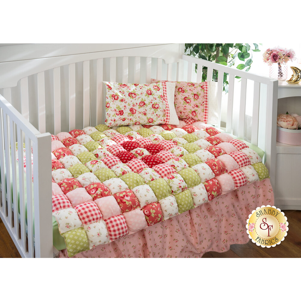 The adorable Sophie Bubble Quilt laid in a crib