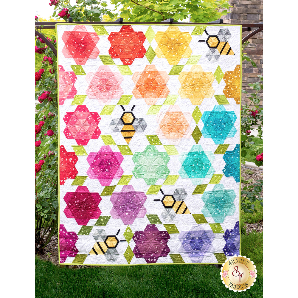 The beautiful Bumblebee Blossoms Quilt displayed outside | Shabby Fabrics