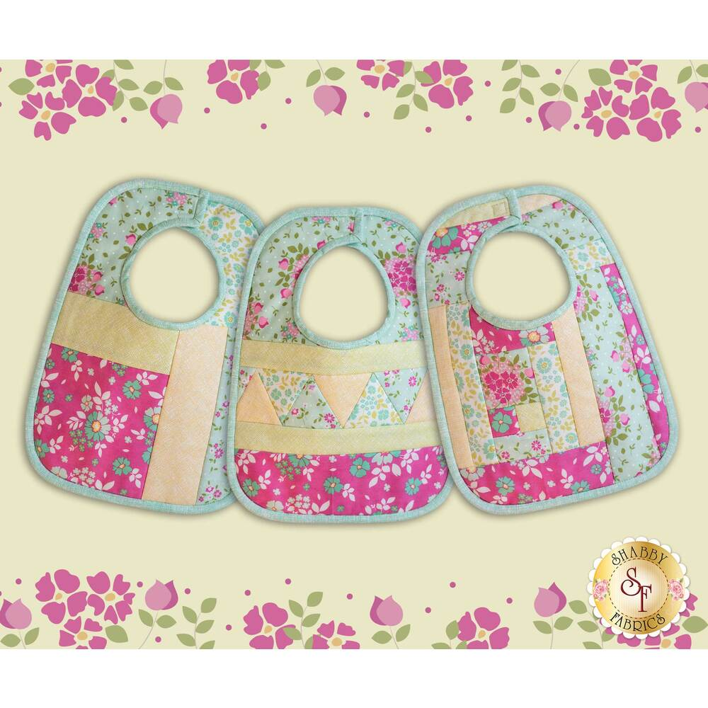 The three beautiful Canning Day Baby Bibs in Aqua