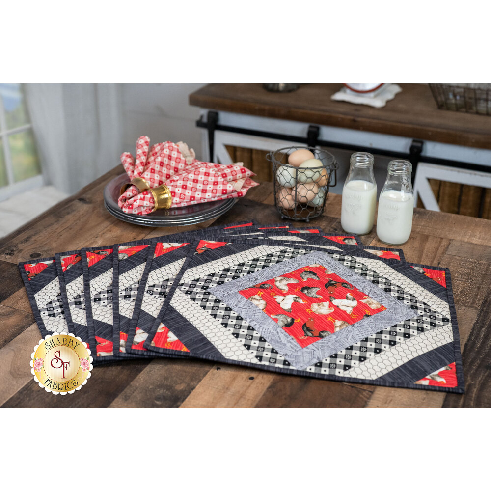 Six casablanca placemats fanned on a dark wood table
