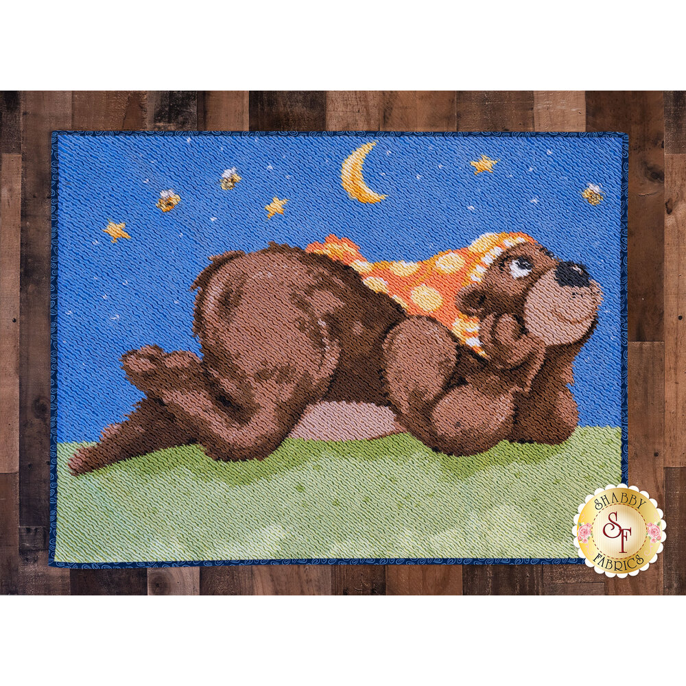 The Barron the Bear Chenille Rug laid flat on a hardwood floor