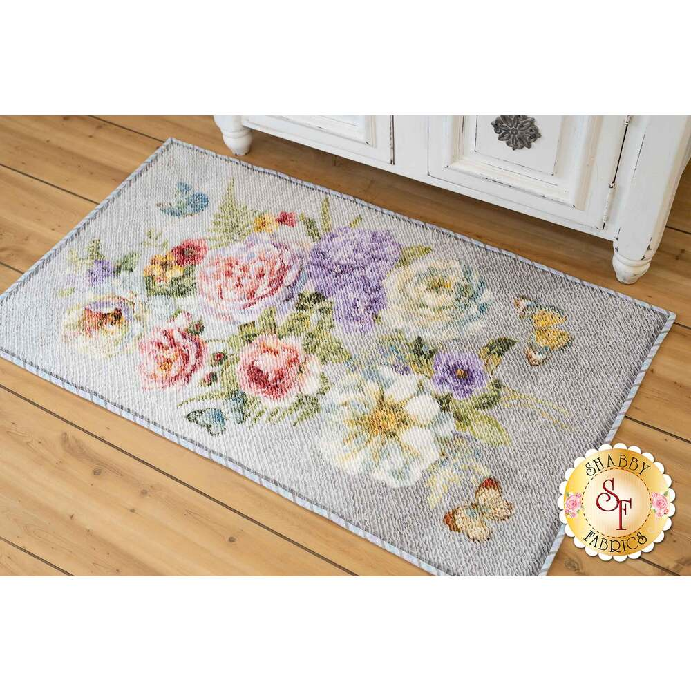 Floral Chenille Butterfly Haven Rug displayed on wooden floor in front of white shabby chic dresser.