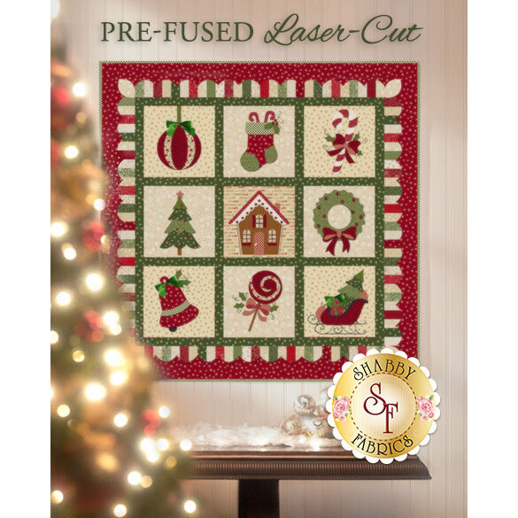 9 block laser-cut applique quilt featuring Christmas motifs: stocking, ornament, Christmas tree.