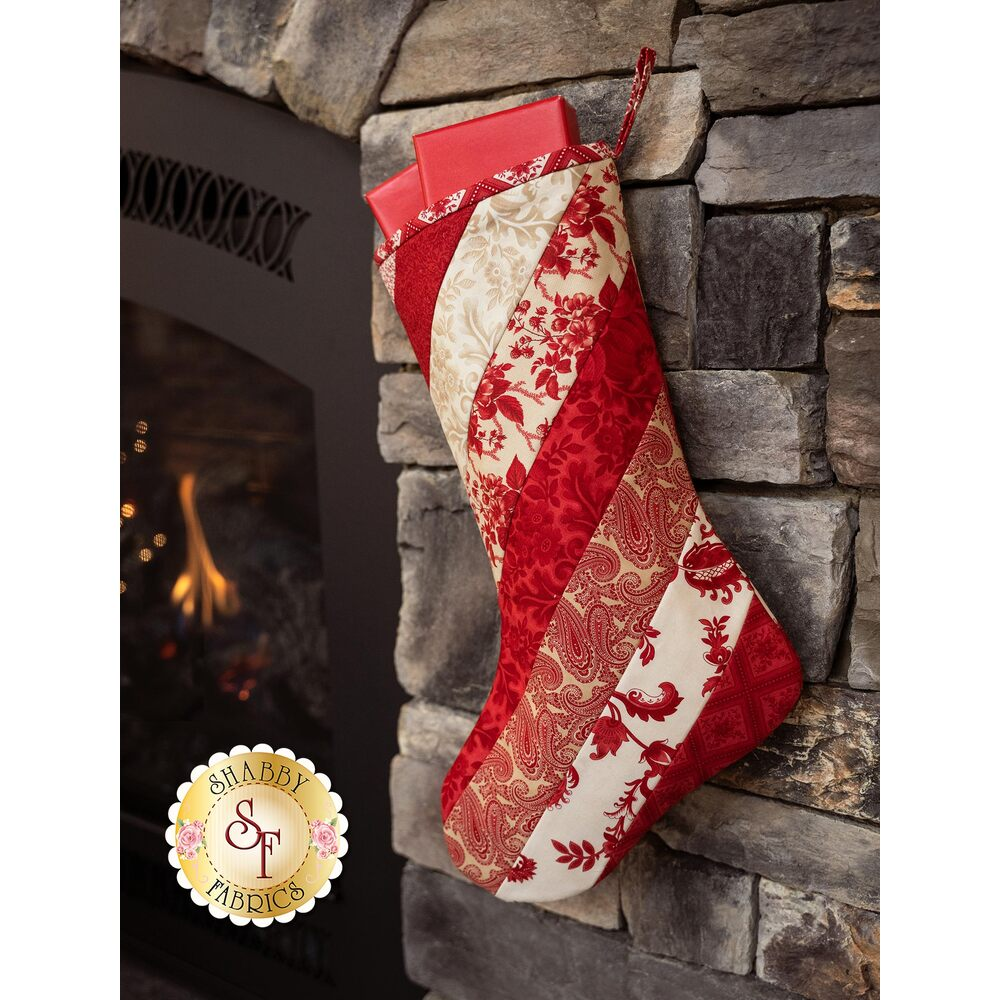 A beautiful red and white striped Christmas stocking using the Cinnaberry fabrics