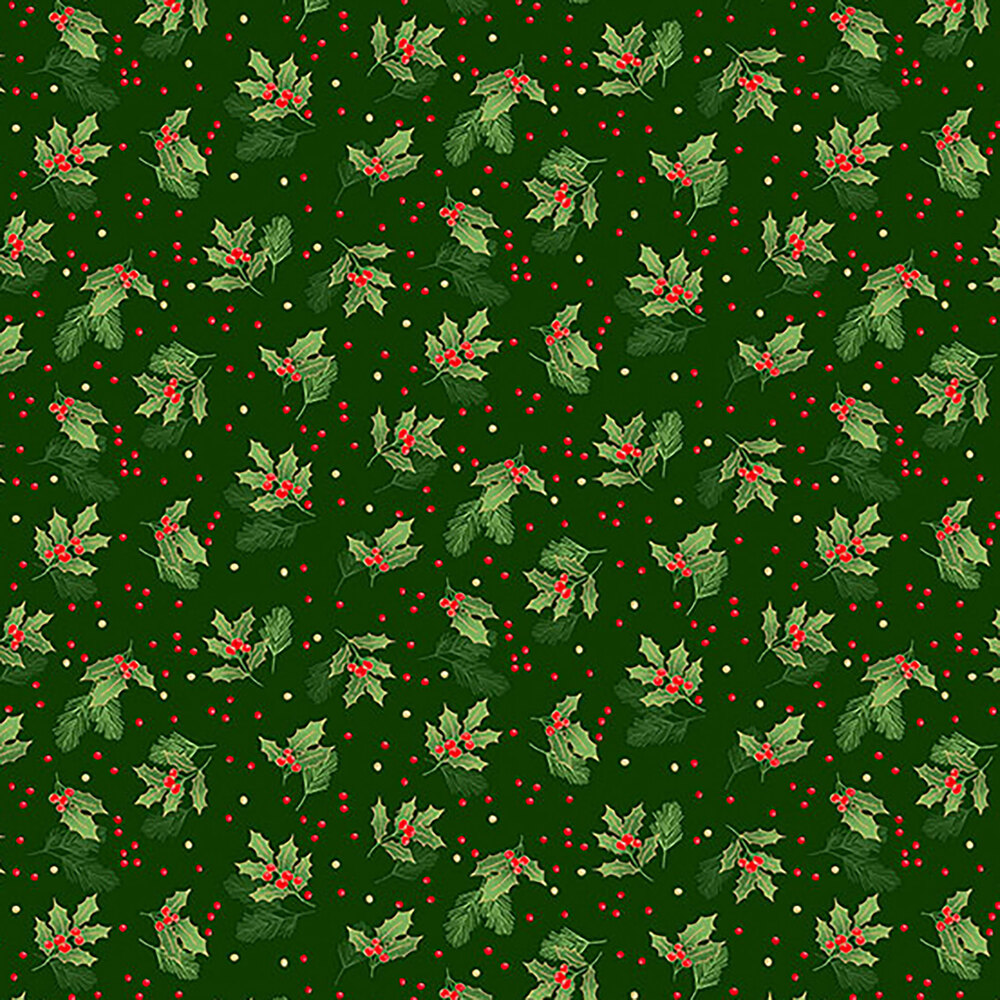 Tossed holly leaves on a green background