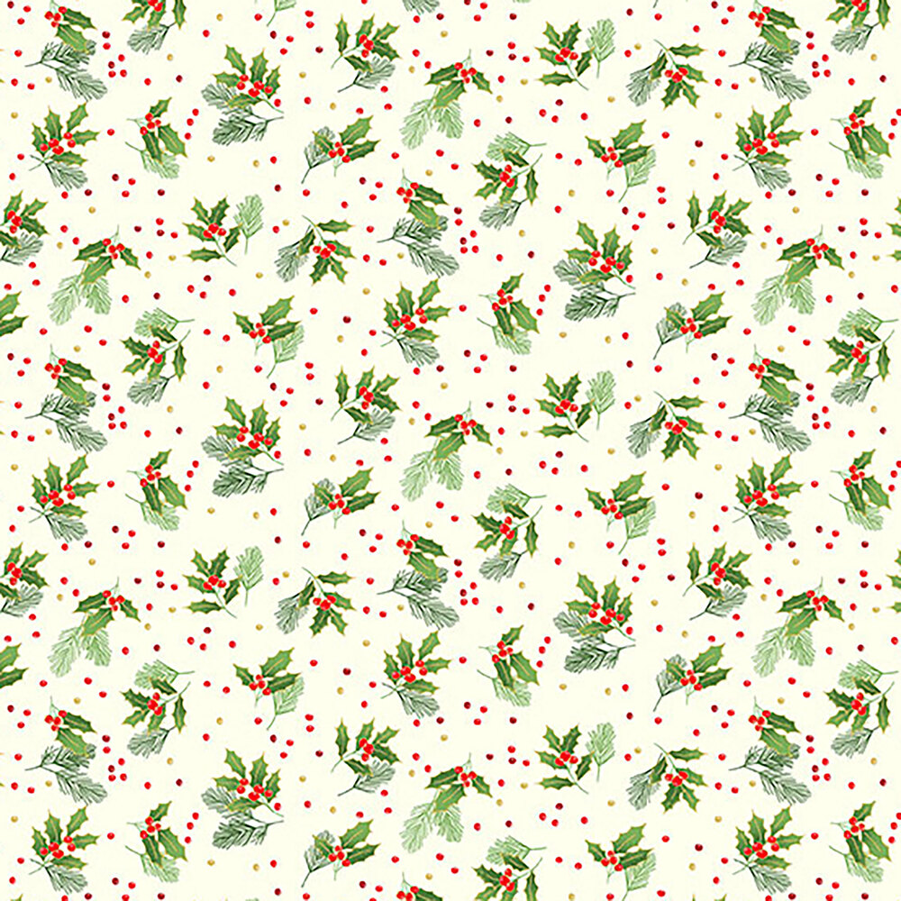 Tossed holly leaves on a cream background
