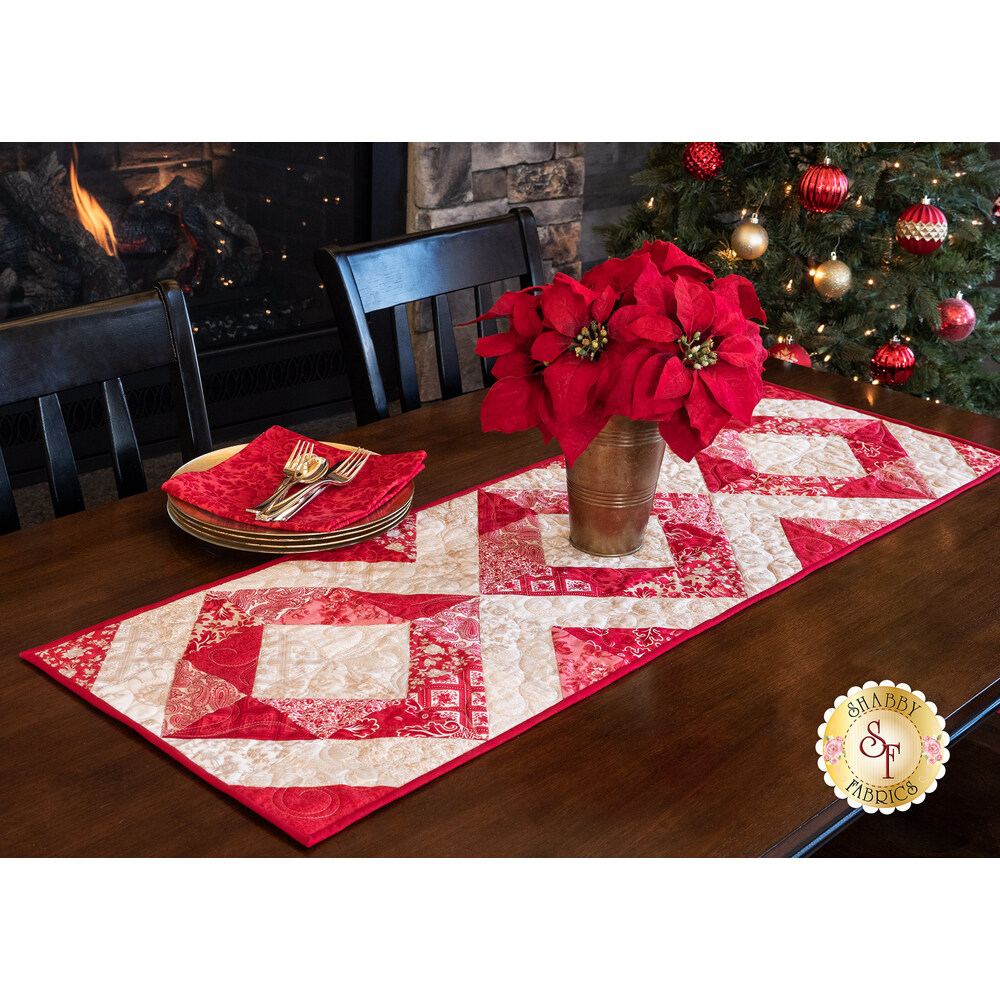 Red and cream diamond table runner on a dark brown table