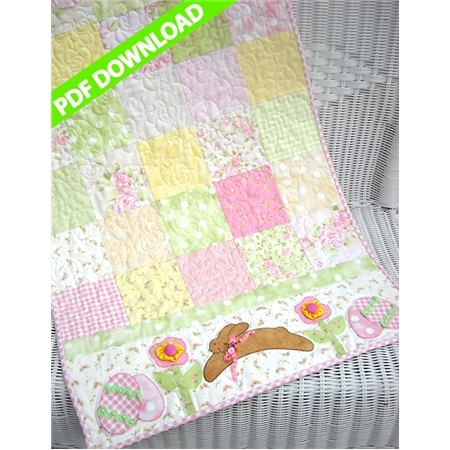 Pink and green pastel patchwork table runner with a brown bounding bunny applique.
