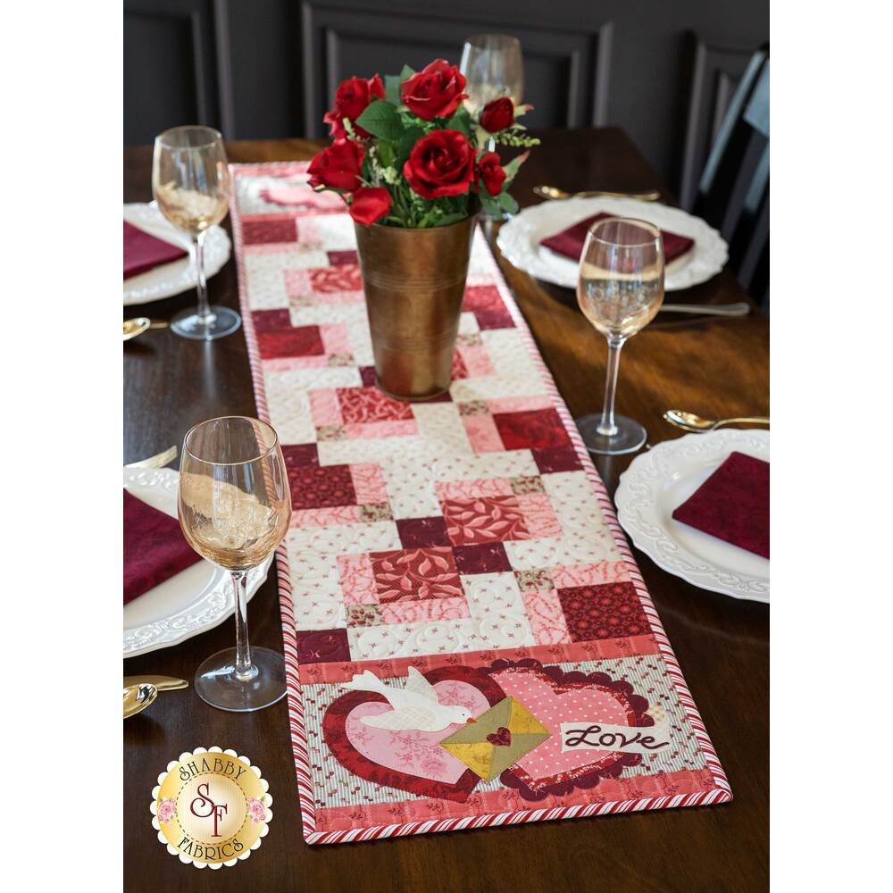 The full February Easy Pieced Table Runner displayed on a set table