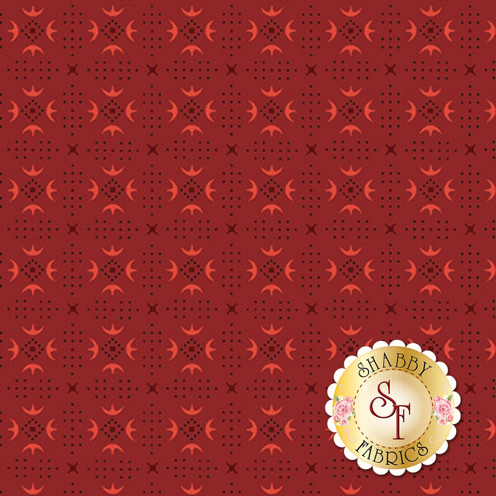 Turkey track patterns around small dots forming diamonds on a red background   Shabby Fabrics