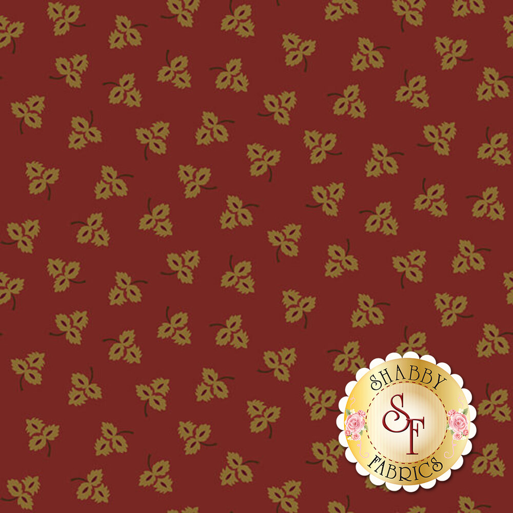 Small golden tossed leaves all over a red background | Shabby Fabrics
