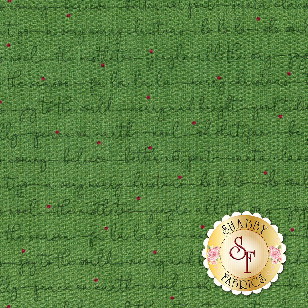 Christmas sayings in cursive on a green background | Shabby Fabrics