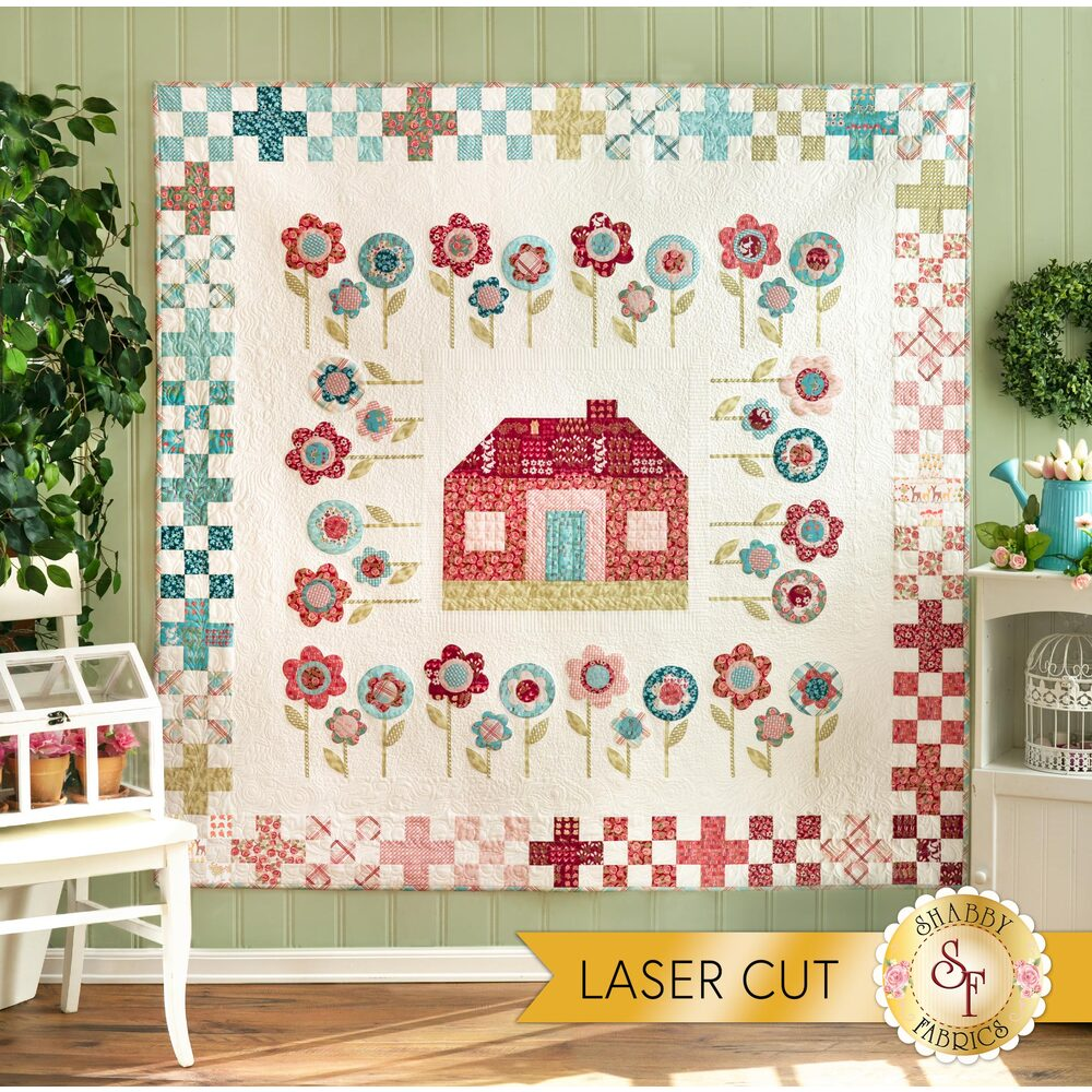 Adorable springtime farmhouse quilt displayed on a wall