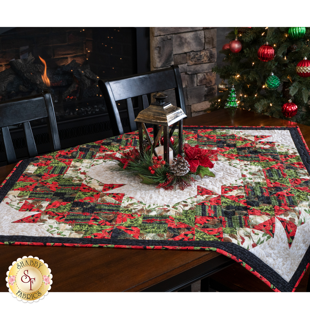 Square table topper draped over a table with a beautiful centerpiece