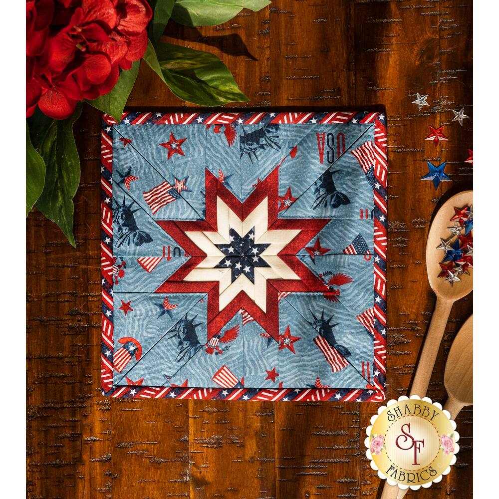 Red, white, and blue square hot pad laid flat on a brown wood table