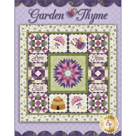 Purple and green garden themed patchwork quilt. Embroidered blocks read Love, Hope, Faith, Charity.