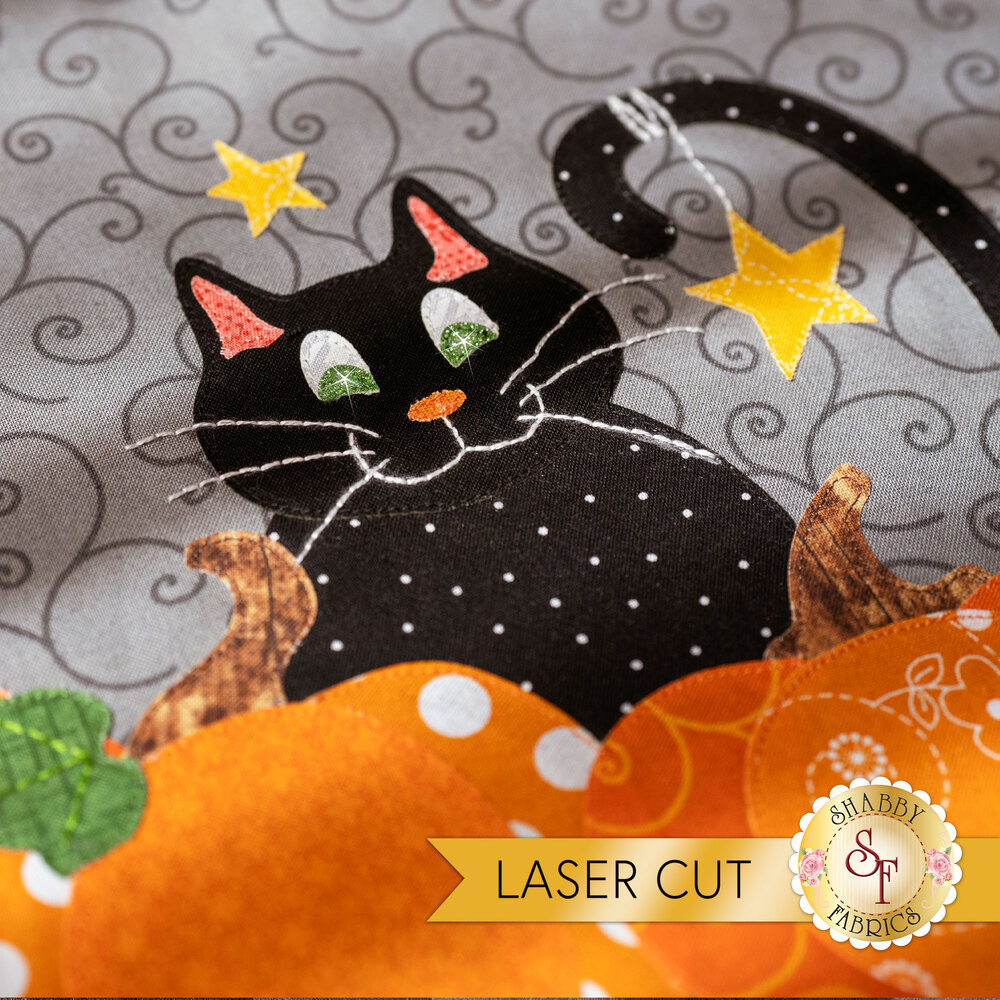 An adorable black cat block in the Too Cute To Spook Mystery BOM