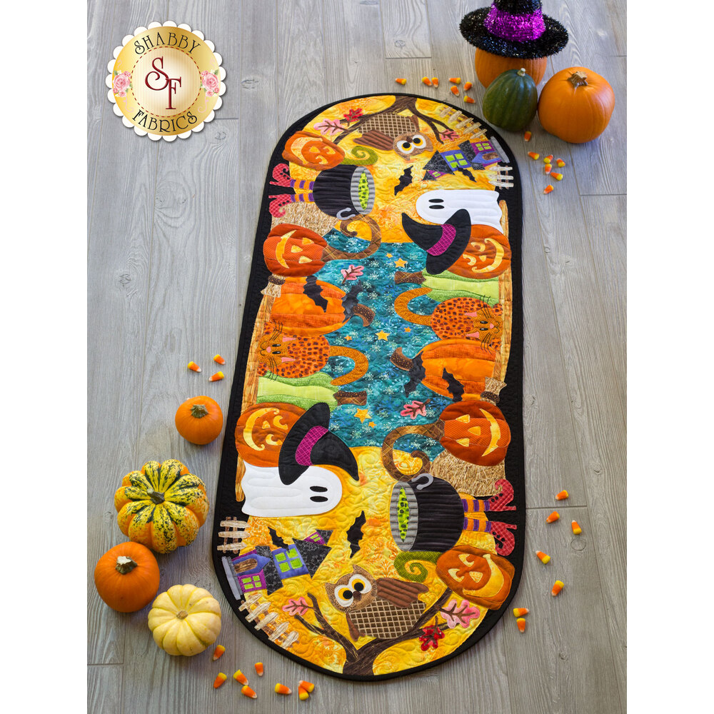 Charming Halloween pumpkin patch with owls, ghosts, and a large full moon.