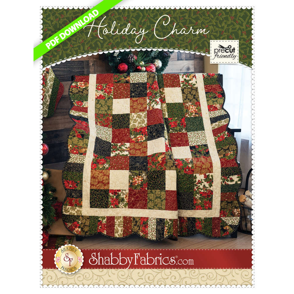 A red, pale green, and pale blue patchwork quilt made from squares with a scalloped border.