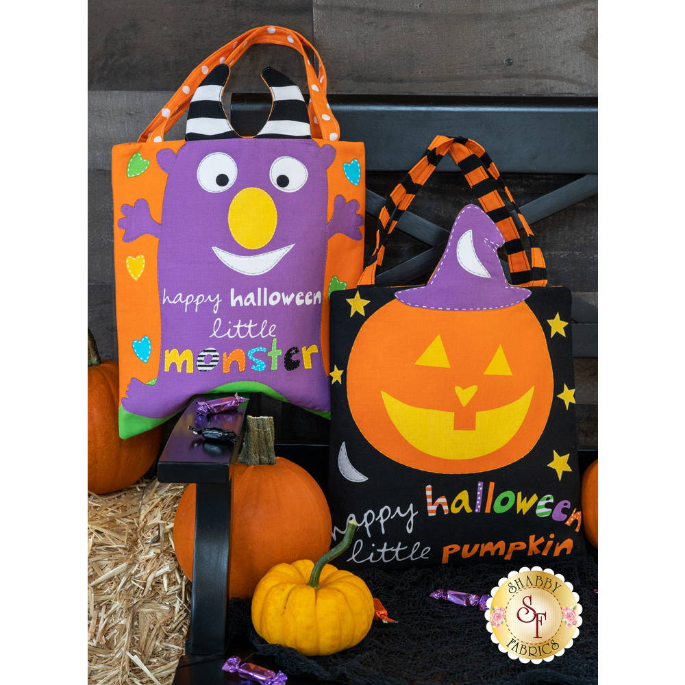 Both Huggable & Loveable Halloween Totes displayed on a chair