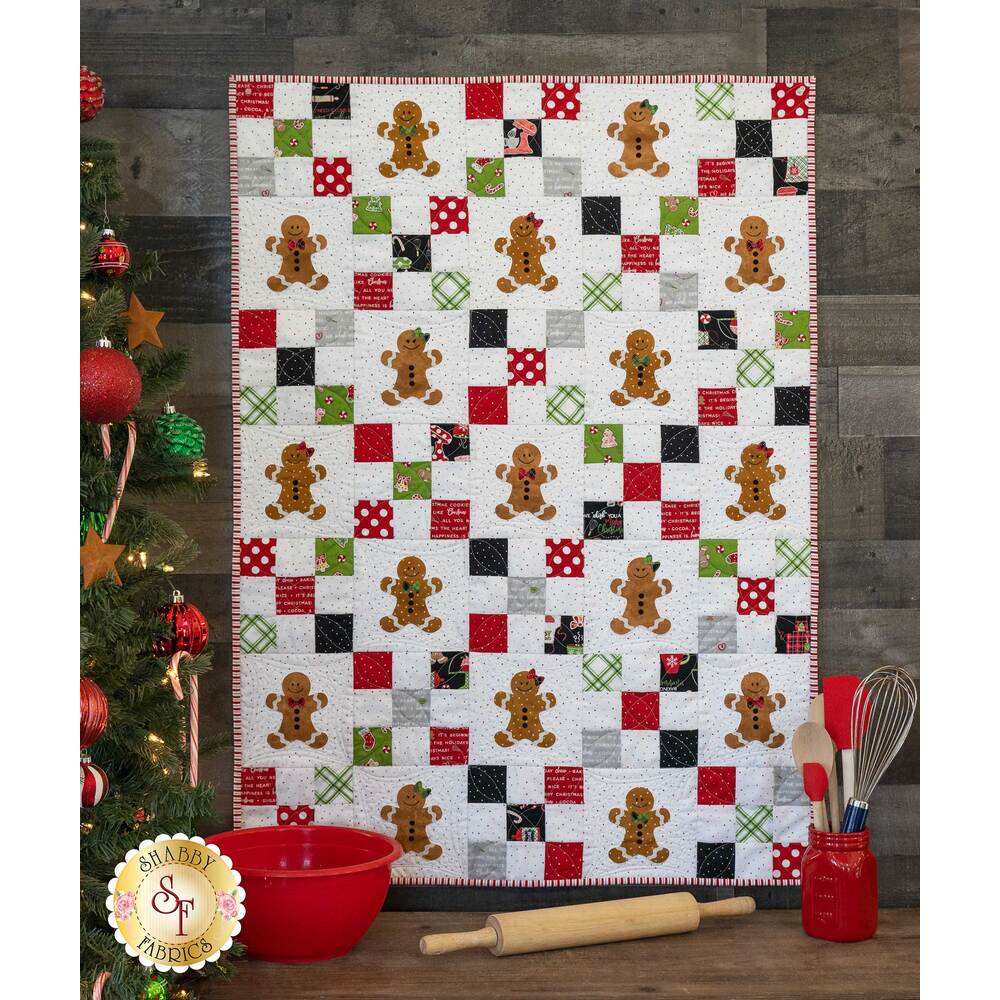 Pieced We Whisk You A Merry Christmas quilt with 17 applique gingerbread people