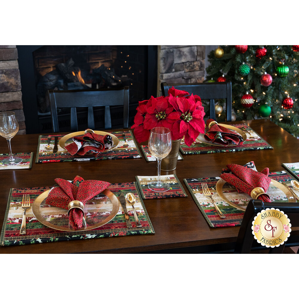 A beautiful set table with the Hoffman Christmas 2019 placemats, coasters, and napkins