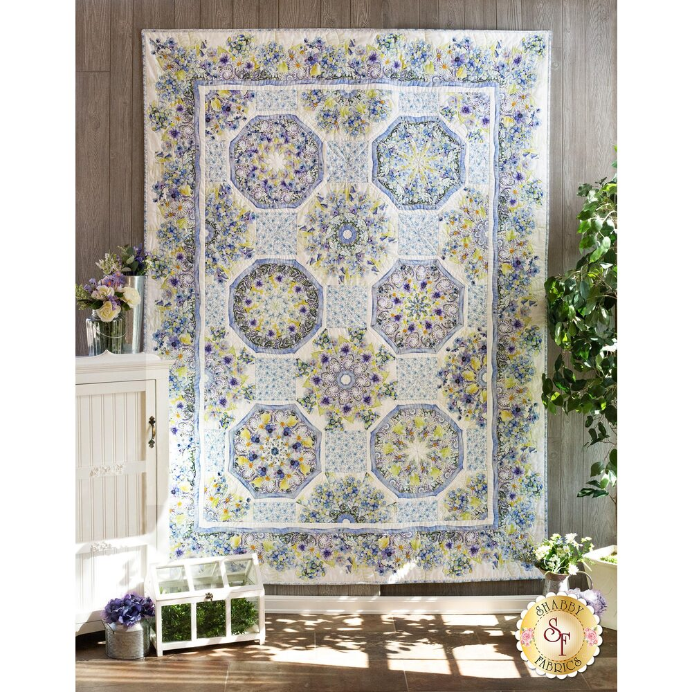 The beautiful Kaleidoscope Quilt made with The Leah Collection fabrics hung on a wall